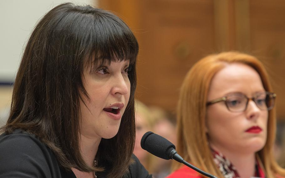 Alexis Witt, widow of Air Force Staff Sgt. Dean Witt, testifies during a hearing on Capitol Hill in Washington on Tuesday, April 30, 2019. Also testifying at right is Air Force veteran Rebecca Lipe.