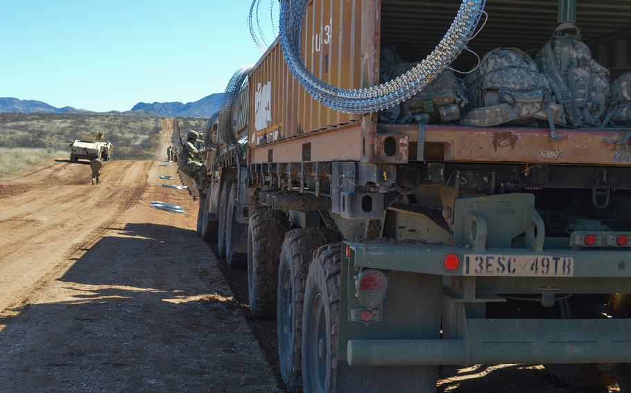 A military vehicle faces east at the border wall in Sasabe, Ariz., Feb. 7, 2019.
