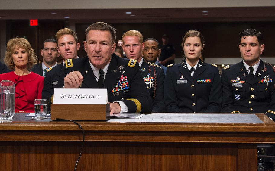 Gen. James McConville introduces his family at a hearing on Capitol Hill in Washington on Thursday, May 2, 2019, as members of the Senate Armed Services Committee considered the general's nomination to become the Army's next chief of staff. Looking on in the background are from left, McConville's wife, Maria, an Army veteran; his son Michael, an Army captain; his son-in-law Ryan Nanzer, an Army staff sergeant; his daughter Jessica Nanzer, an Army captain; and his son Ryan, also an Army captain.