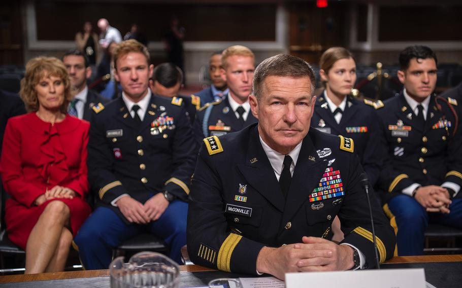 Gen. James McConville prepares to introduce his family during a hearing on Capitol Hill in Washington on Thursday, May 2, 2019, as members of the Senate Armed Services Committee considered the general's nomination to become the Army's next chief of staff.