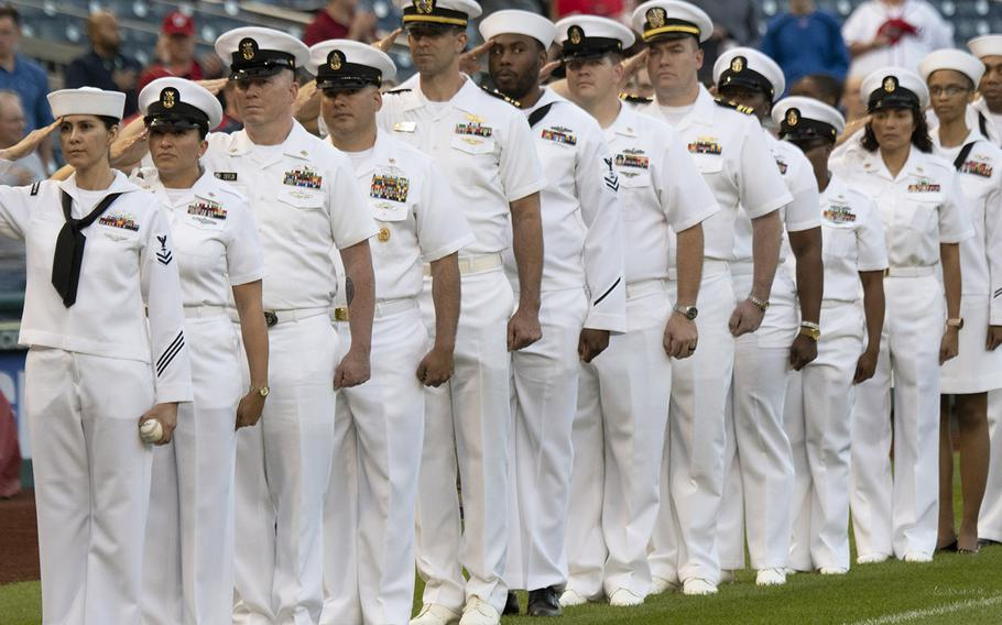 Sailors salute as the national anthem is played during Navy Night ceremonies at Nationals Park in Washington, D.C., May 1, 2019.