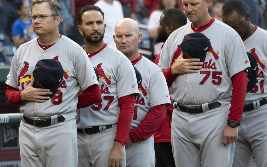St. Louis Cardinals manager Mike Shildt (8) and his coaches stand for the national anthem during Navy Night ceremonies at Nationals Park in Washington, D.C., May 1, 2019.