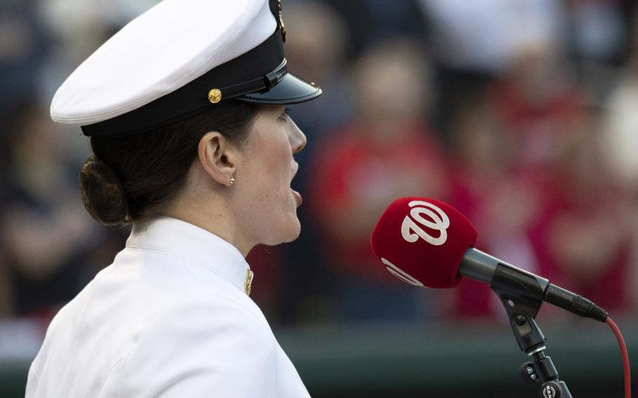 Musician 1st Class Maia Rodriguez, a member of the U.S. Navy Band, sings the national anthemduring Navy Night ceremonies at Nationals Park in Washington, D.C., May 1, 2019.