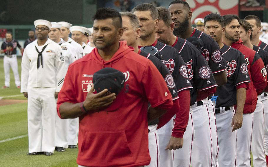 Washington Nationals manager Dave Martinez and his coaches and players stand for the national anthem during Navy Night ceremonies at Nationals Park in Washington, D.C., May 1, 2019.