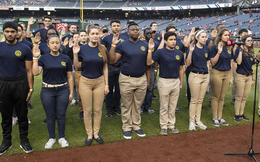 An enlistment ceremony spotlighted 45 new U.S. Navy sailors during Navy Night ceremonies at Nationals Park in Washington, D.C., May 1, 2019.