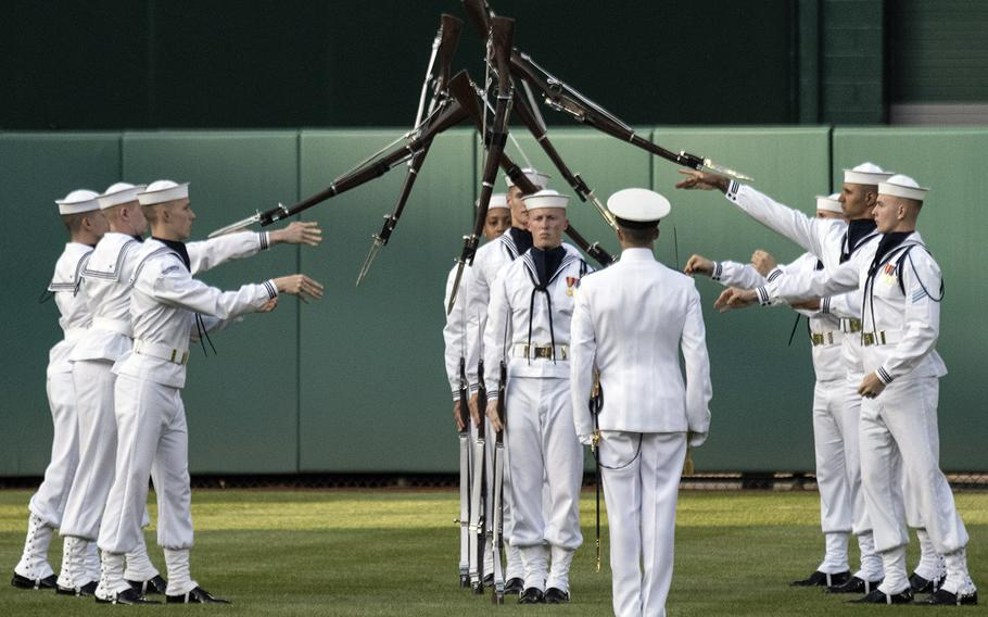 The U.S. Navy Drill Team performs in the outfield during Navy Night ceremonies at Nationals Park in Washington, D.C., May 1, 2019.