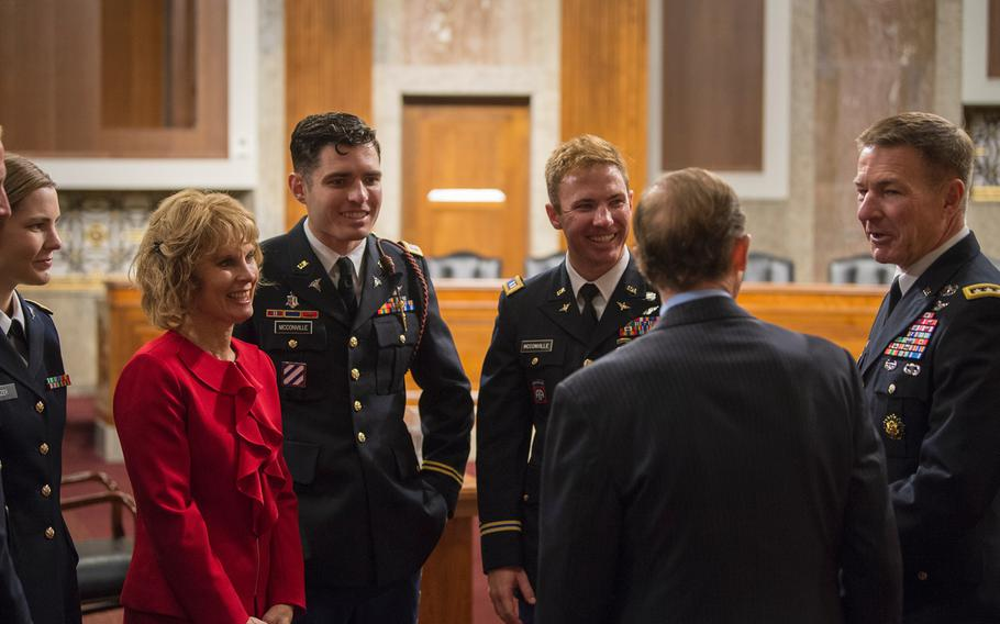Gen. James McConville speaks with Sen. Richard Blumenthal, D-Conn., prior to the start of a Senate Armed Services Committee hearing to consider McConville's nomination to become the Army's next chief of staff. Looking on from right to left are the general's family members: sons Michael and Ryan, both Army captains, wife Maria, daughter Jessica Nanzer, an Army captain and her husband, not seen, Army Staff Sgt. Ryan Nanzer.
