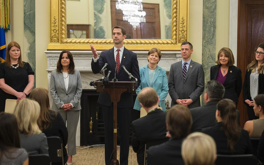 Sen. Tom Cotton, R-Ark., takes questions in the Russell Senate Building on Capitol Hill in Washington on Thursday, May 9, 2019. Joining Cotton in promoting efforts to make it easier for military spouses' occupational licenses to be portable from state to state are from left: Navy spouse Andrea Krull; second lady Karen Pence, wife of Vice President Mike Pence; Sen. Jeanne Shaheen, D-N.H; Rep. Jim Banks, R-Ind; Rep. Susan Davis, D-Calif; and Air Force spouse Brittany Boccher.