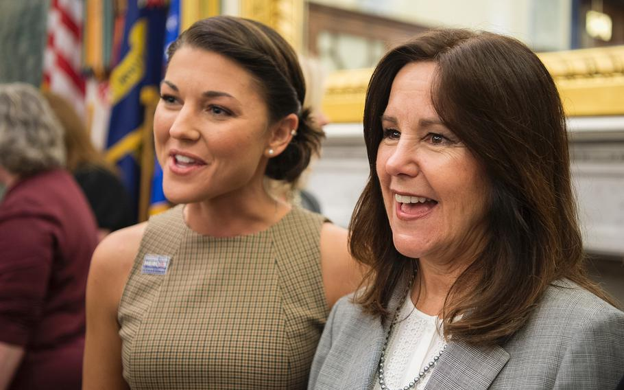 Second lady Karen Pence, wife of Vice President Mike Pence, has her picture taken with Navy spouse Lindsay Bradford after a briefing in the Russell Senate Building on Capitol Hill in Washington on Thursday, May 9, 2019.