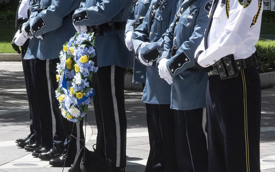 Officers from the Adams County, Colo., Sheriff's Department and the Mount Dora Police take their turn as honor guard during National Police Week at the National Law Enforcement Officers Memorial in Washington, D.C., May 14, 2019.