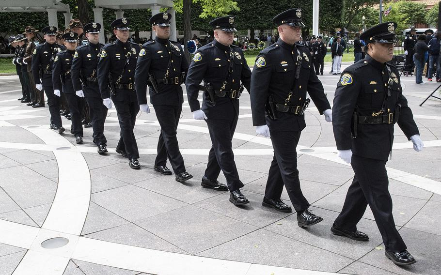 The Pomona, Calif., police honor guard marches during National Police Week at the National Law Enforcement Officers Memorial in Washington, D.C., May 14, 2019.