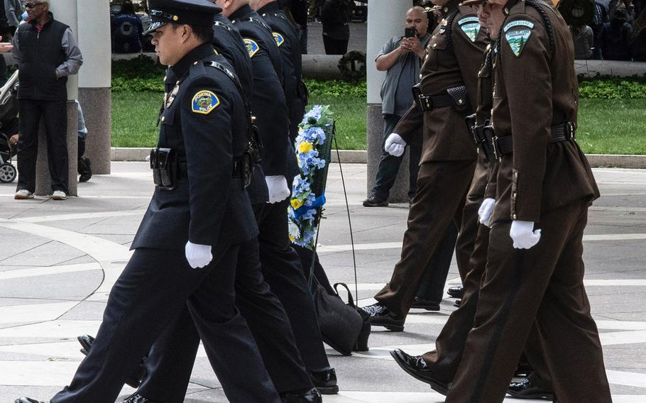 Honor guard representatives of the Pomona, Calif., police department, left, and the Bureau of Land Management change shifts during National Police Week at the National Law Enforcement Officers Memorial in Washington, D.C., May 14, 2019.