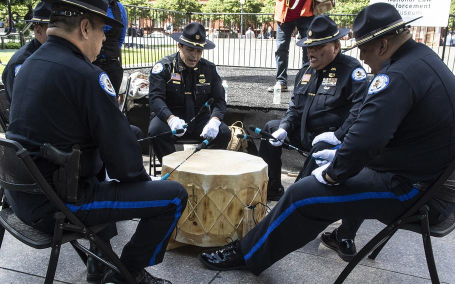 Native American police officers take part in a drum ceremony during National Police Week at the National Law Enforcement Officers Memorial in Washington, D.C., May 14, 2019.