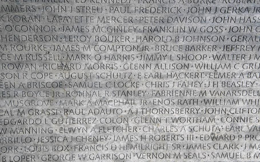 At the National Law Enforcement Officers Memorial in Washington, D.C., some of the more than 21,000 names of officers who have been killed in the line of duty in the U.S. since 1791 are seen on one of the two 304-foot-long marble walls.