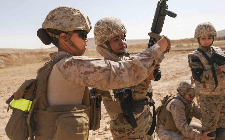 U.S. Marine Sgt. Nicole Turner, left, and a soldier from the Jordan Armed Forces-Arab Army clear a weapon after completing a live fire combat marksmanship range in Zarqa, Jordan on April 23, 2019.