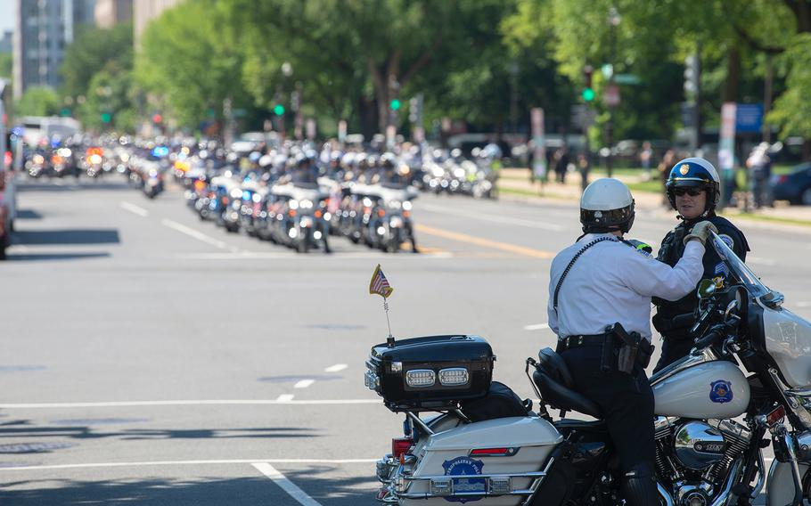 Police officers and vehicles line the streets around the U.S. Capitol in Washington on Wednesday, May, 15, 2019, as thousands gathered for a memorial service to honor law enforcement personnel who have fallen in the line of duty.