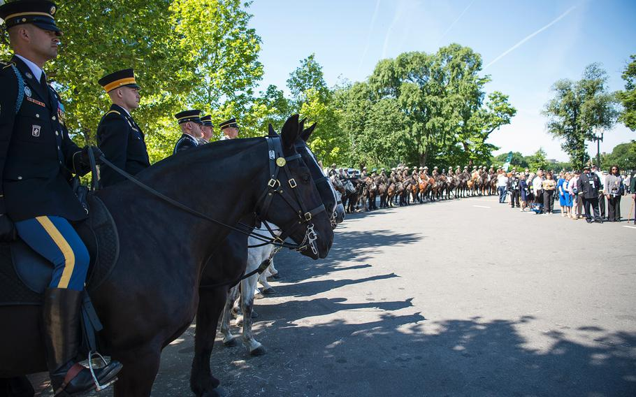 Horse-mounted police serve as an honor guard welcoming the thousands of people streaming into the U.S. Capitol in Washington on Wednesday, May, 15, 2019, for the 38th annual national memorial service to honor law enforcement personnel who have fallen in the line of duty.
