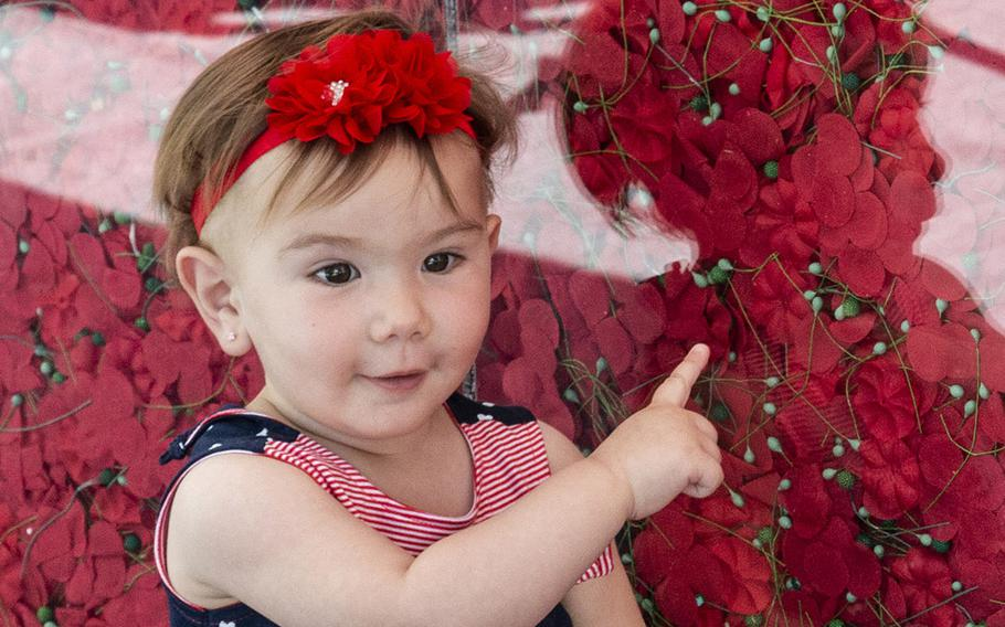 Thirteen-month-old Ava Khoury points out the flowers on USAA's Poppy Wall of Honor on the National Mall in Washington, D.C., May 24, 2019.