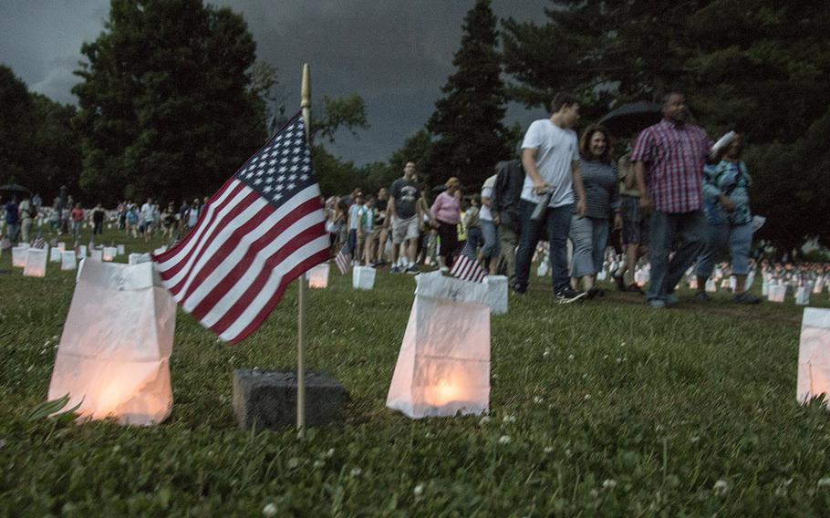 A thunderstorm chases visitors from the site during the 24th annual luminaria at Fredericksburg National Cemetery in Fredericksburg, Va., May 25, 2019.