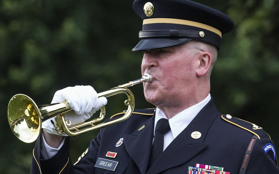 Retired Army Staff Sgt. J.B. Greear plays taps at the 24th annual luminaria at Fredericksburg National Cemetery in Fredericksburg, Va., May 25, 2019.