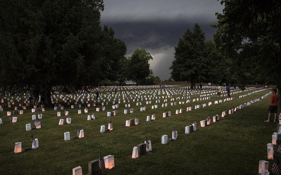 Storm clouds loom during the 24th annual luminaria at Fredericksburg National Cemetery in Fredericksburg, Va., May 25, 2019. Minutes later, the storm forced the evacuation of the cemetery.