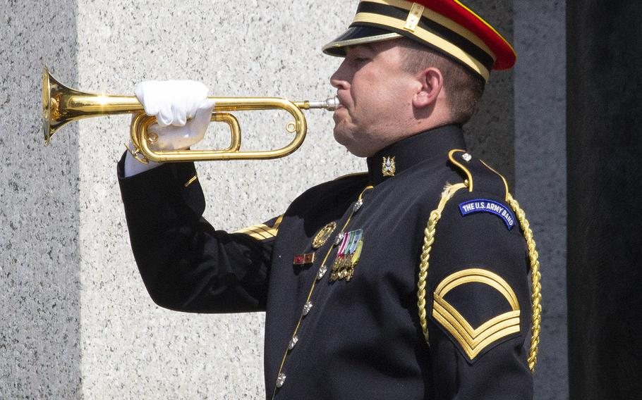 A bugler plays taps on Memorial Day at the National World War II Memorial in Washington, D.C., May 27, 2019.