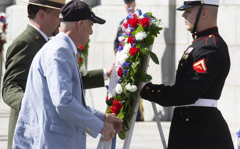 National Park Service Acting Superintendent Jeffrey Reinbold and World War II veteran Carmel Whetzel place a wreath during a Memorial Day ceremony at the National World War II Memorial in Washington, May 27, 2019.