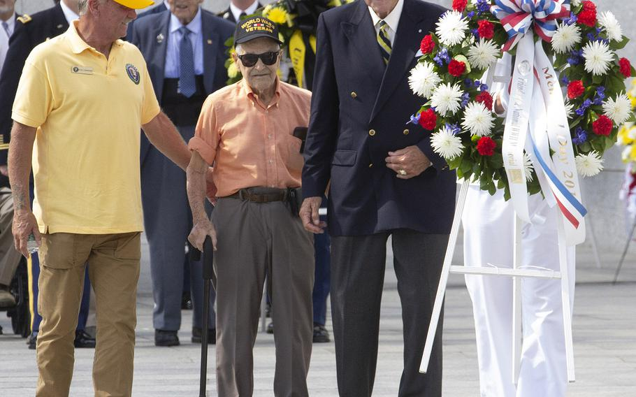 Army Air Force veteran Lou Perrone, who served as a ball turret gunner in a B-17 Flying Fortress during World War II, prepares to place a wreath at the National World War II Memorial in Washington on Memorial Day, May 27, 2019. With him is the chairman of the Friends of the National World War II Memorial, Josiah Bunting III.