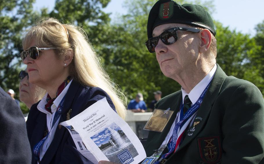Visitors listen to a speaker on Memorial Day at the National World War II Memorial in Washington, D.C., May 27, 2019.