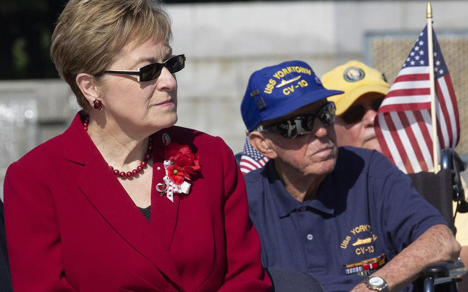 Rep. Marcy Kaptur, D-Ohio, and World War II veteran Andrew Abugelis listen to a speaker on Memorial Day at the National World War II Memorial in Washington, D.C., May 27, 2019.