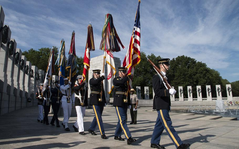 The Armed Forces Color Guard of the Military District of Washington, on Memorial Day at the National World War II Memorial in Washington, D.C., May 27, 2019.