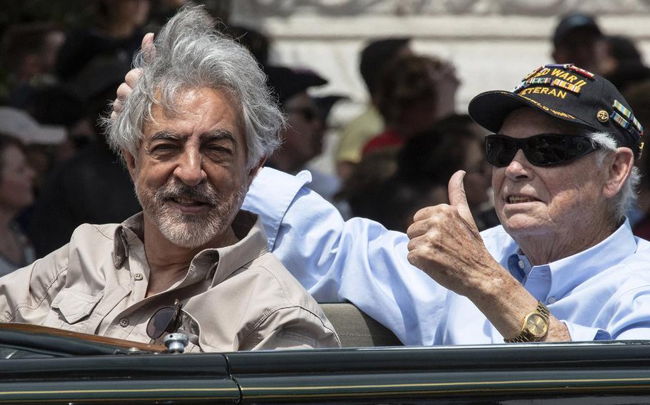 Actor Joe Mantegna rides with a World War II veteran in the National Memorial Day Parade in Washington, D.C., May 27, 2019.