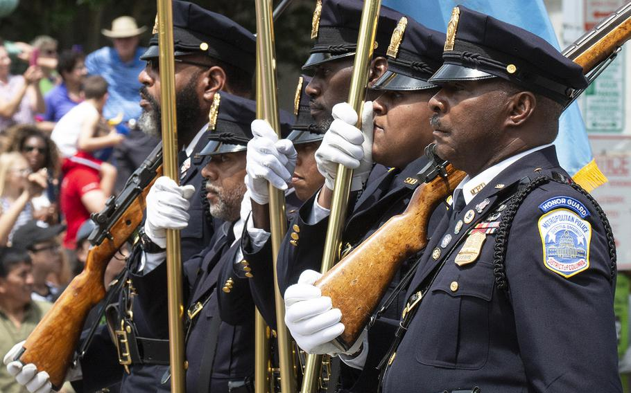 The Washington, D.C. Police honor guard marches in the National Memorial Day Parade, May 27, 2019.