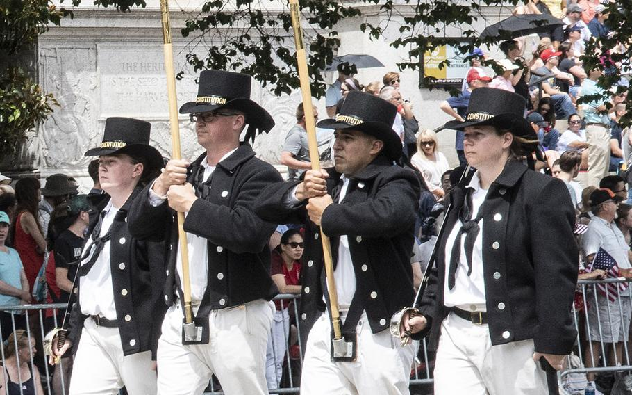 Sailors from the Boston-berthed USS Constitution, the world's oldest commissioned warship afloat, march in the National Memorial Day Parade in Washington, D.C., May 28, 2019.