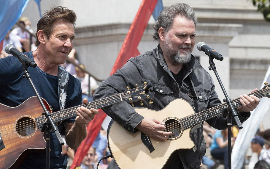 Quaid and James — actor Dennis Quaid and Canadian singer-songwriter Jamie James — perform at the National Memorial Day Parade in Washington, D.C., May 27, 2019.