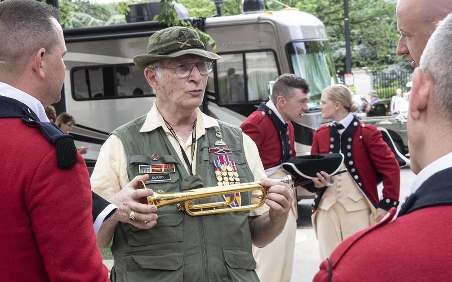 Mark Elrod, who was part of the Old Guard's Fife and Drum Corps years ago, talks with current members before the National Memorial Day Parade in Washington, D.C., May 27, 2019.