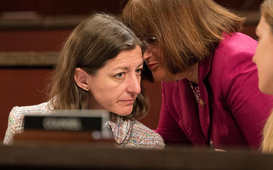 Rep. Annie Kuster, D-N.H., right, whispers to Rep. Elaine Luria, D-Va., during a hearing on Capitol Hill in Washington on Thursday, June 20, 2019. The hearing examined the Department of Veterans Affairs' decisions about disability benefits for veterans who claim they suffer from post-traumatic stress disorder related to military sexual assault.