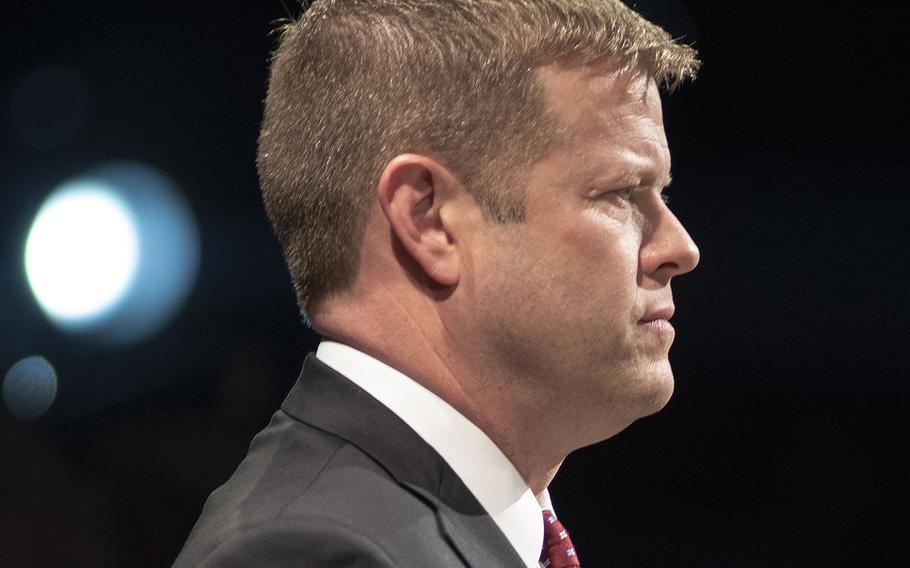 Under Secretary of the Army Ryan McCarthy stands for the national anthem during an event at Fort Myer-Henderson, Va., on Wednesday June 19, 2019.