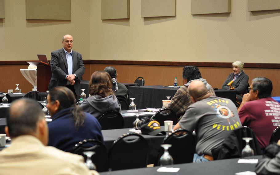 Paul Sullivan, who works in veteran outreach for the law firm Bergmann & Moore, addresses a group of veterans at the Ohkay Hotel Casino in Okay Owingeh, N.M., on Tuesday, Nov. 6, 2018. Sullivan and attorney Carol Wild Scott held a two-day workshop to educate Native American veterans about getting connected to VA benefits.