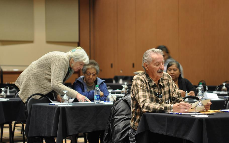 Carol Wild Scott, chairman of the Veterans and Military Law Section of the Federal Bar Association, assists a veteran's family on Tuesday, Nov. 6, 2018, at the Ohkay Hotel Casino in Ohkay Owingeh, N.M. Scott traveled to the pueblo to educate veterans about getting connected to VA benefits.