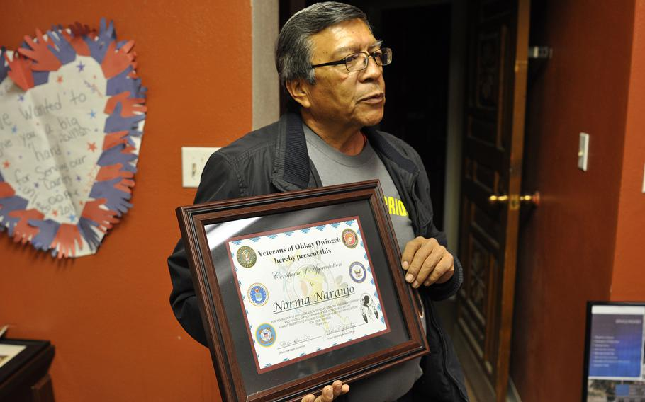 Michael Montoya, an advocate for veterans in Ohkay Owingeh, N.M., holds up one of the certificates he planned to present to a returning veteran from his pueblo. When veterans and servicemembers return to Ohkay Owingeh, they're often treated to the traditional Butterfly Dance, which Montoya said promotes healing.