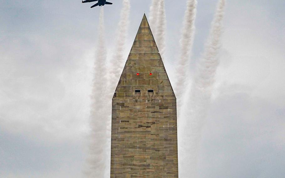 The U.S. Navy flight demonstration squadron, the Blue Angels, fly over the Washington Monument during a Fourth of July celebration in Washington, D.C., July 4, 2019.