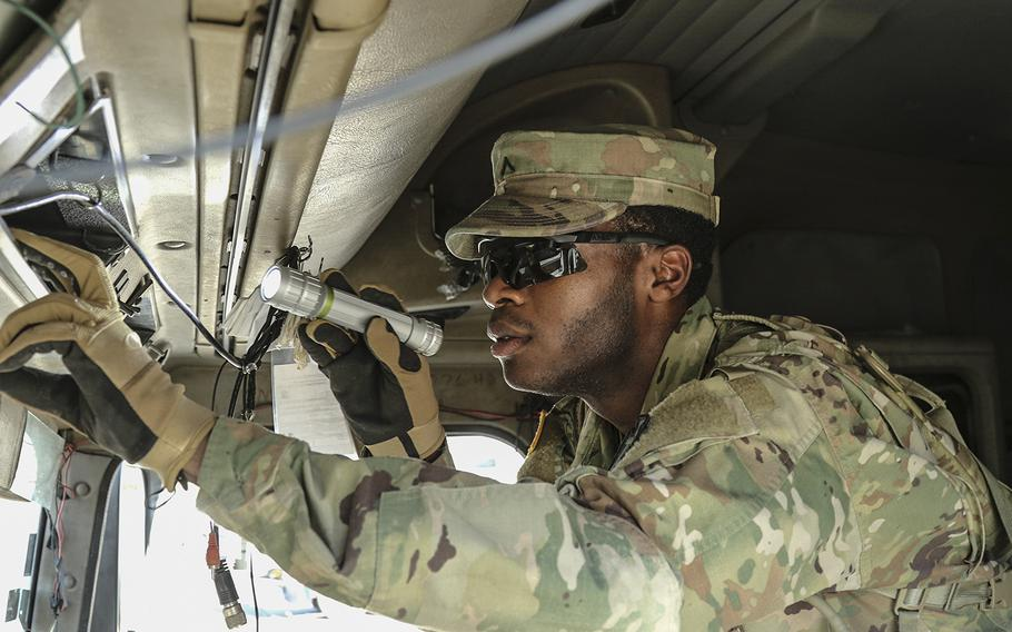 In a July 11, 2018 photo, Pvt. DeVante Williams, 1st Battalion, 124th Cavalry Regiment, searches through the cab of an 18-wheeler at the Texas-Mexico border's Eagle Pass point of entry as Texas guardsmen, part of Operation Guardian Support, assist Customs and Border Patrol agents.