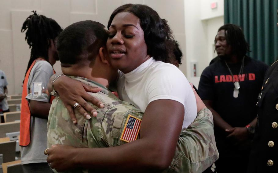 Myeshia Johnson, the widow of Sgt. LaDavid Johnson, right, hugs a member of the military after a ceremony awarding the Silver Star Medal to LaDavid Johnson, Friday, Aug. 16, 2019, in Miami Gardens, Fla. Johnson was killed in action during operations in Niger in 2017.