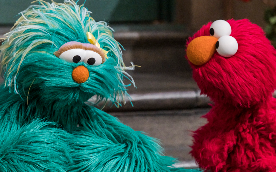Rosita and Elmo talk in one of the Sesame Street for Military Families: Caregiving videos.