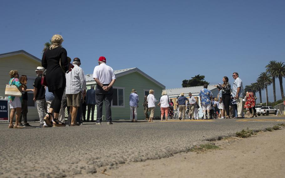 Marines and their family members, along with representatives from the San Diego Nice Guys charity and Marine Corps Community Services, tour new beach cottages before a dedication ceremony at San Onofre Beach on Marine Corps Base Camp Pendleton, Calif., Aug. 15, 2019.