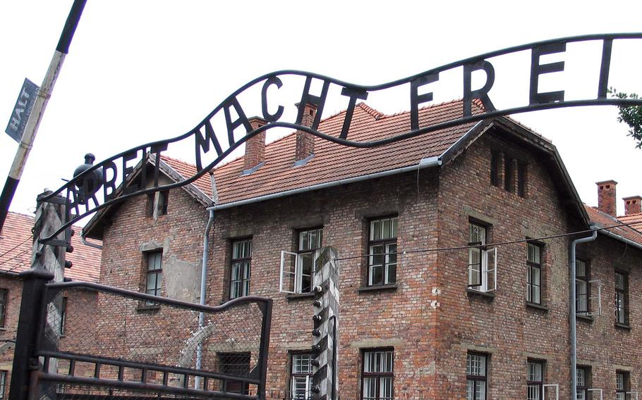 """The infamous sign at the gate of the Auschwitz prison camp in Poland saying """"Arbeit Macht Frei."""""""