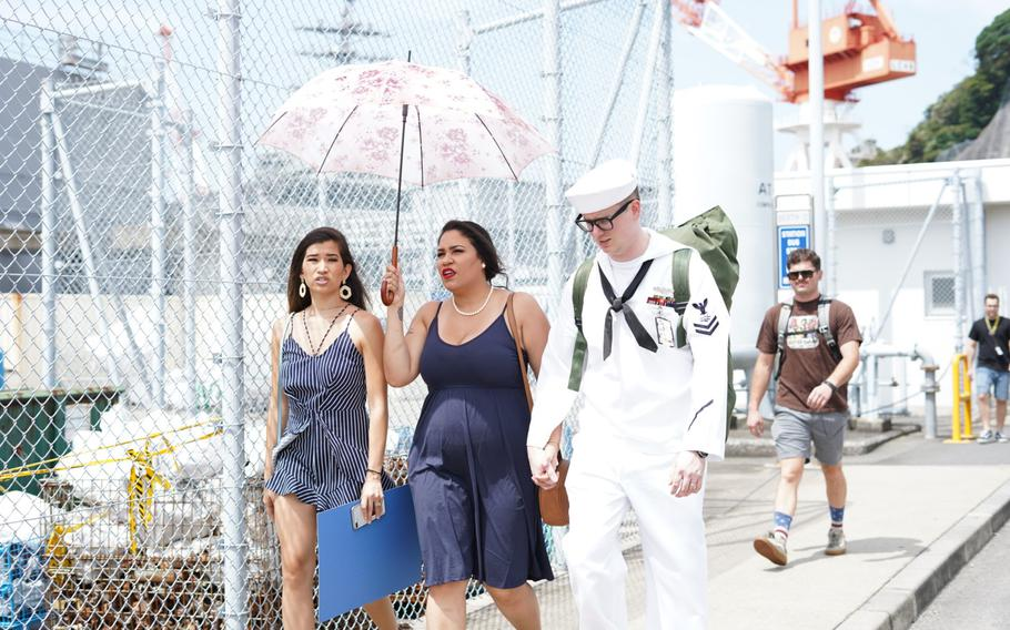 A sailor assigned to the USS Ronald Reagan, at sea in the western Pacific Ocean for three months, returned home to Yokosuka Naval Base, Japan, on Saturday, Aug. 24, 2019.