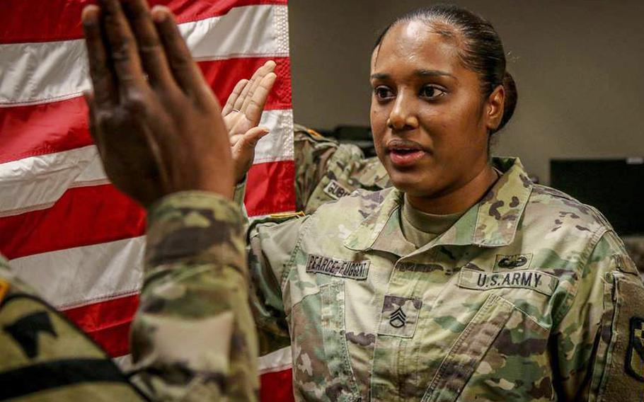 In a December, 2018 file photo, Staff Sgt. Kayle Pearce-Fuggent of HHC 525th Military Intelligence Brigade, a human resources specialist from Miami, Fla., takes the oath of reenlistment leading up to a special duty assignment in Fort Sill, Oklahoma as a Drill Sergeant.