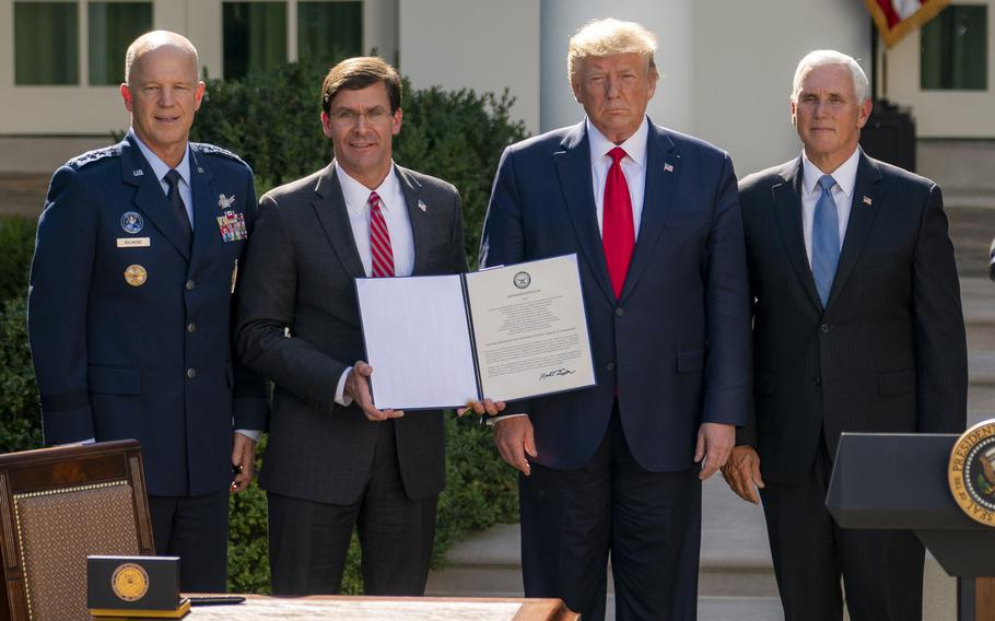 From left: Air Force Gen. Jay Raymond, Secretary of Defense Mark Esper, President Donald Trump and Vice President Mike Pence pose after a a White House ceremony establishing the new U.S. Space Command on Thursday, Aug. 30, 2019.